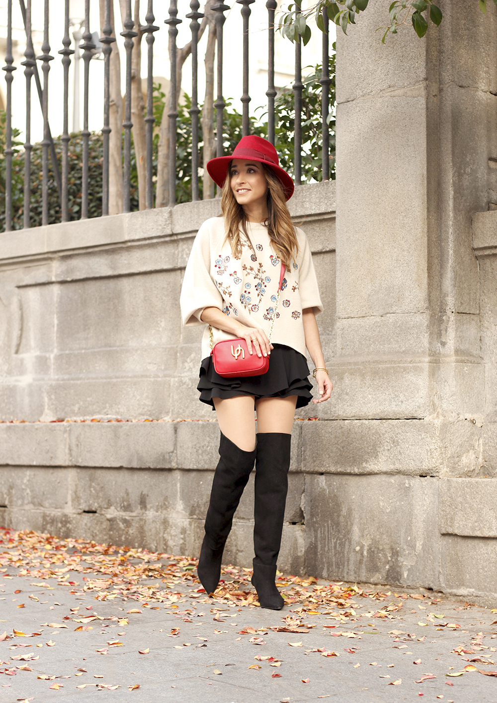 beige jersey with embroidered flowers over the knee black boots red hat street style fashion inspiration outfit06