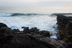 Wave reaches a cliff, tanah lot, bali