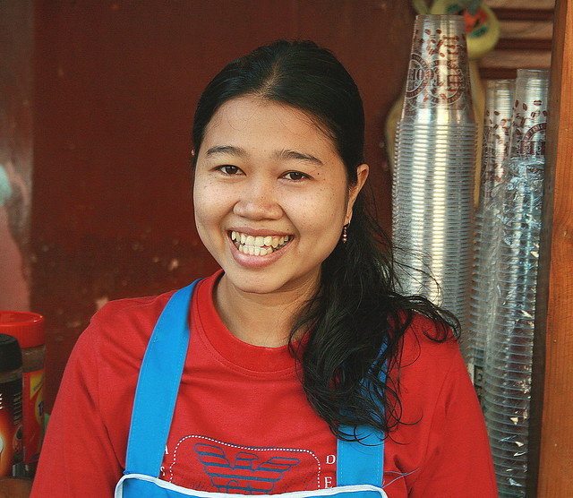big smile from a pretty food vendor