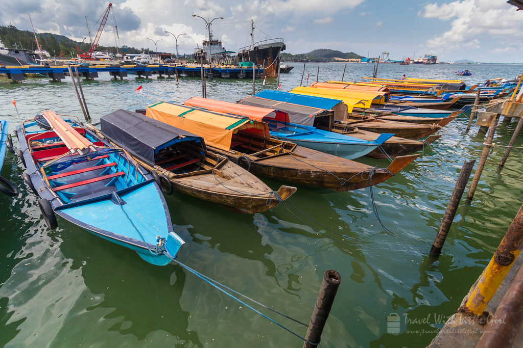 A series of wooden boats at the Batam Jetty