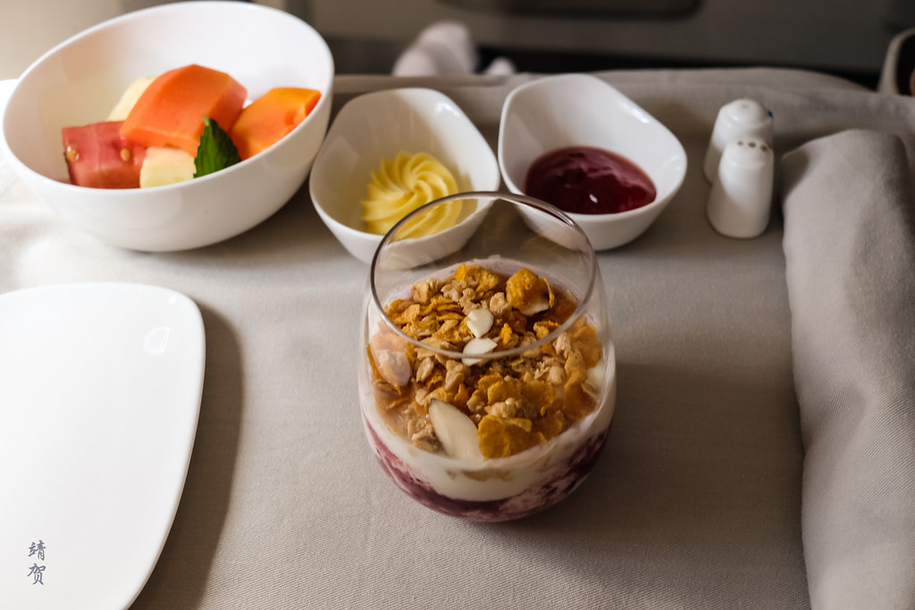 Yogurt with granola, and fruit bowl