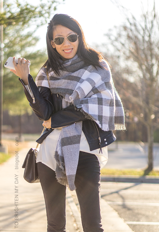 oversized plaid blanket scarf, black leather jacket, silk button up shirt, black shoulder bag, black skinny jeans