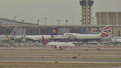 TACA Embraer E190 N989TA British Airways Boeing 747-400 G-BYGF Lufthansa Airbus A330 D-AIKN Dallas Fort Worth Airport webcam capture