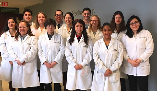 13 members of the 2016 NGL lab in white coats