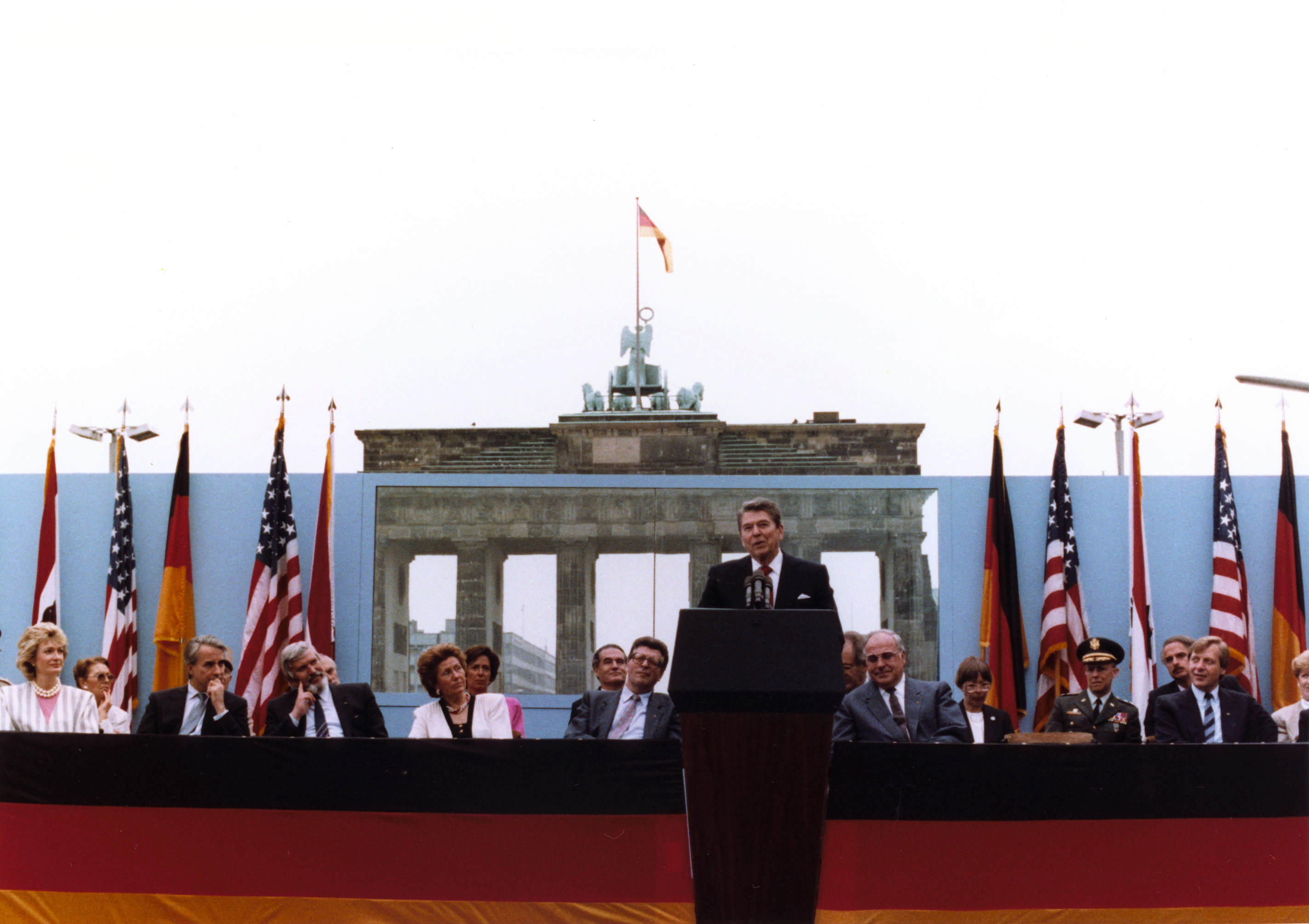 Ronald Reagan at the Brandenburg Gate challenges Soviet premier Mikhail Gorbachev to tear down the Berlin Wall on June 12, 1987, shortly before the end of the Cold War.