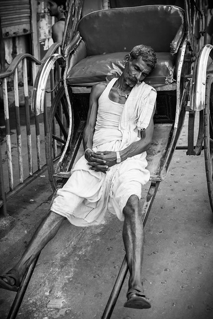 Most of pullers do not own the rickshaw, they have to rent it, Calcuta, India