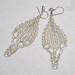 La Boutique Extraordinaire - Diana Brennan - Boucles d'oreilles en fil de métal - 60 €