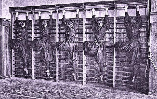 Girls in bloomers on climbing apparatus, Western High School, Washington, D.C 1899