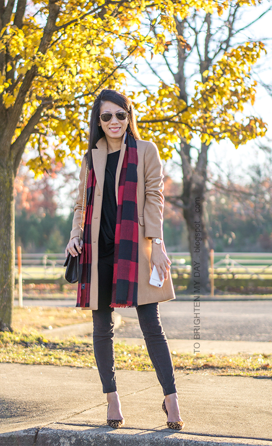 long camel wool coat, red buffalo check scarf, gold watch, black twist front top, black skinny jeans, black shoulder bag, leopard pumps