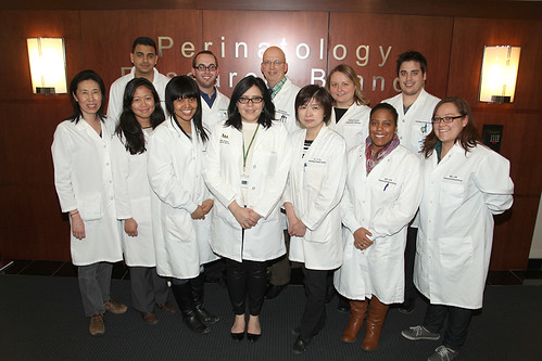 12 members of the 2015 NGL lab in white coats
