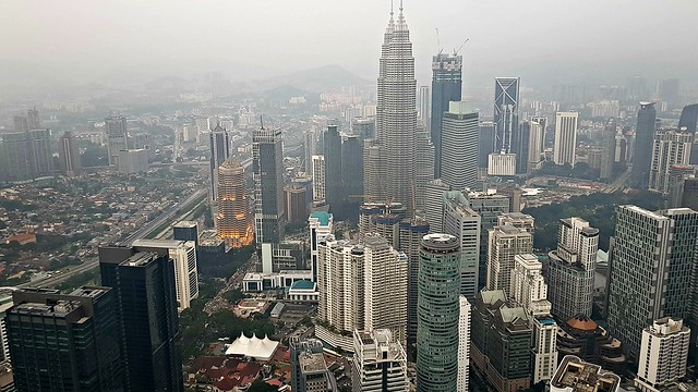 a view at twilight of the Petronas Twin Towers,  seen from the KL Tower at 421m/1377ft above ground level.
