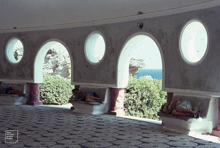 Siesta at Kalithea. Risca at rest. Mary Morris, Meg, Marion Roberts. Floor patterning of sea worn pebbles very characteristic