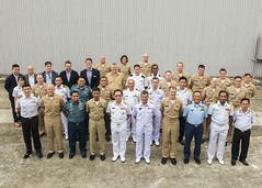 Flag officers from eight South and Southeast Asia nations gather for a group photo after a senior leadership summit, Dec. 6. (U.S. Navy/MC3 Christopher Veloicaza)