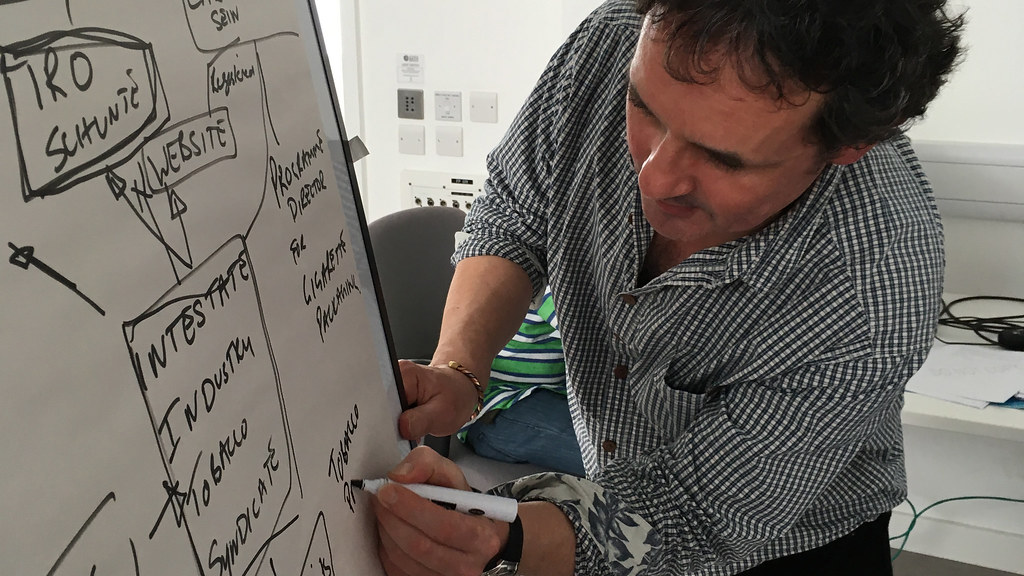 A man writing on a flipchart