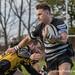 Otley's Declan Jackson takes on a Hinckley defender-0698