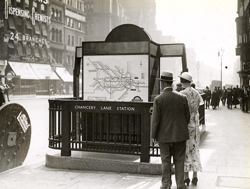 Chancery Lane Station entrance, London Underground, c. 1930s, with posted Harry Beck Tube map
