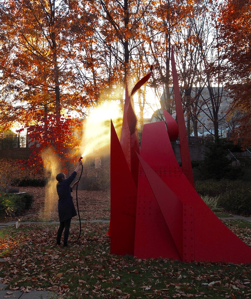 Cleaning the Calder in the BMA sculpture garden.