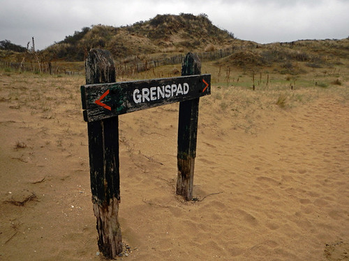 A directional sign for the dunes park in Belgium