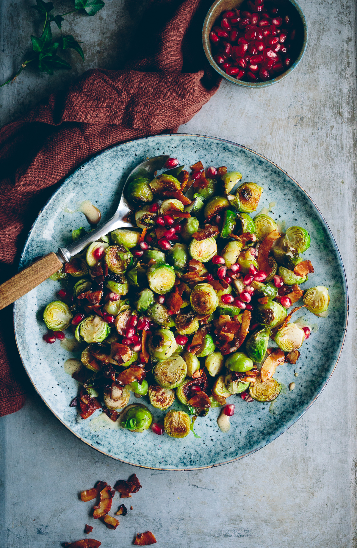 Roasted Brussel Spouts with Coconut Bacon, Pomegranate & Orange Almond Dressing | Cashew Kitchen