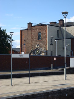 Photo showing former station entrance clock (in the background) at Derby