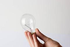 Light bulb in mans hand