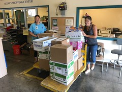 Hawaiian Electric's Holiday Food & Fund Drive - October-November, 2017: Christy T. and Rae I. drop off donations at the Hawaii Foodbank