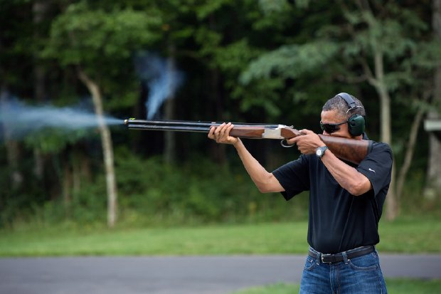 obama shooting a shotgun