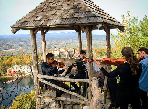 Professors Alex Peh and Christiana Reader led students on a musical hike along the trail to Skytop Tower, the iconic structure that overlooks @mohonkmountainhouse and much of the Shawangunk Mountain range. #npsocial #mohonkmountainhouse #newpaltz #catskil
