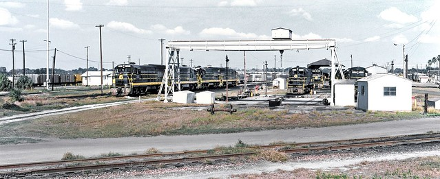 Seaboard Coast Line diesel electric locomotives are seen in the maintenance and shop area of the old railroad yard in Lakeland, Florida, 1974