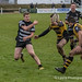Thomas Hodson tries to keep the ball alive as he runs out of space-1057