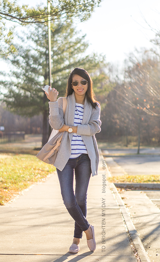 gray shawl cardigan sweater, blue striped top, oversized watch, jeans, beige and gray tote bag, light pink loafers