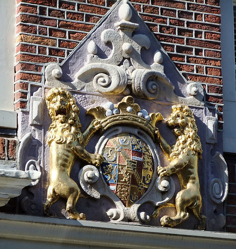 Two golden lions rampart on a crest on a building in Edam, Holland