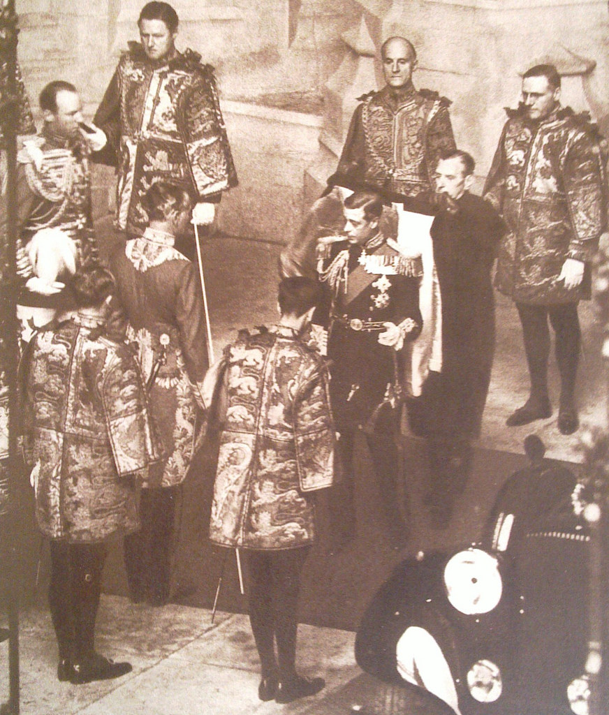 Edward VIII surrounded by heralds of the College of Arms prior to his only State Opening of Parliament in the House of Lords, November 3, 1936.