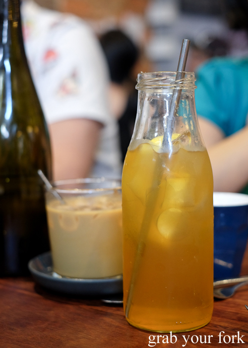 Housemade jasmine iced tea and iced latte at Two Chaps vegetarian cafe in Marrickville