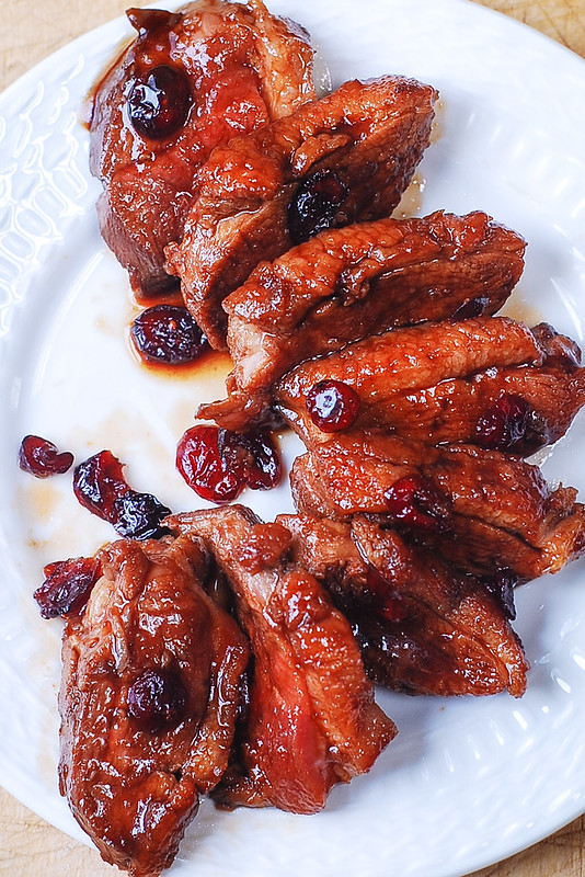 sliced duck breast with cranberries
