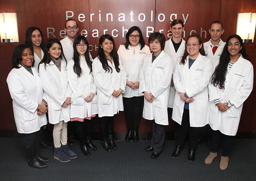 12 members of the 2017 NGL lab with white coats