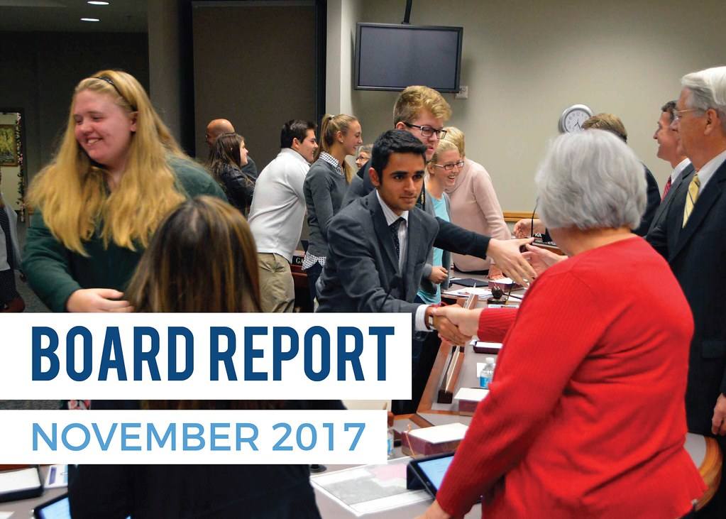 Athletes shaking hands with board members with text 'Board Report | November 2017'