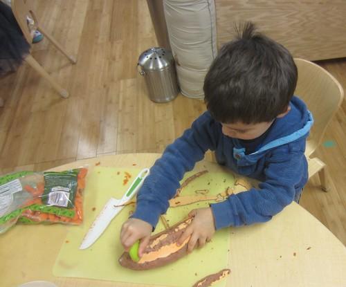 peeling the sweet potato