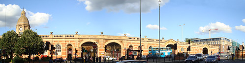A 3-photo panorama of the frontage of Leicester station in the evening sun