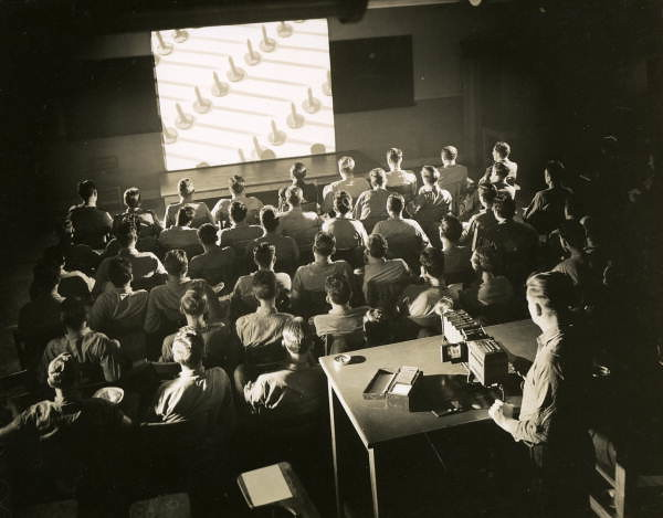 Students viewing slide presentation during a photography class at NAS Pensacola