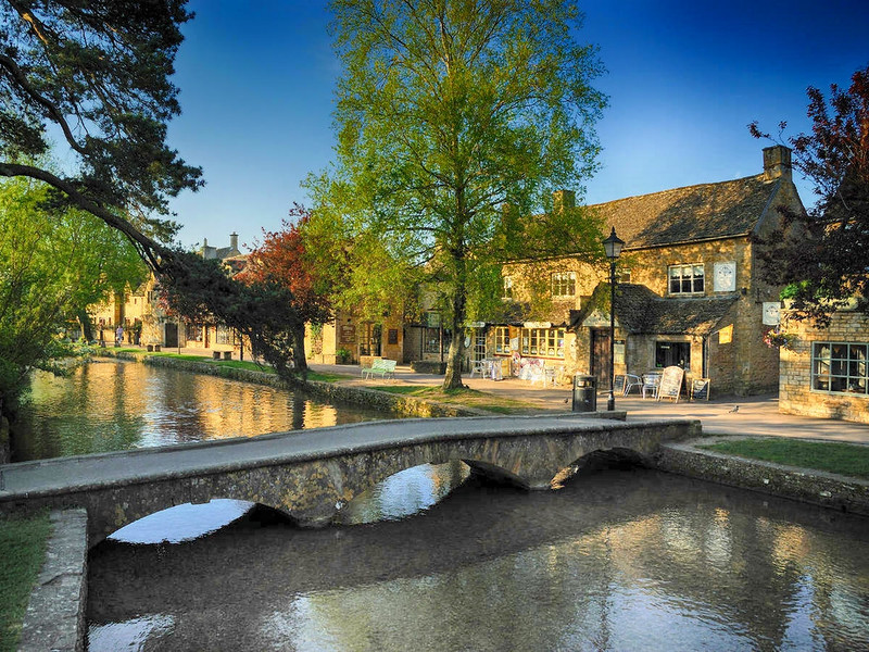 Footbridge over the River Windrush at the Cotswolds village of Bourton-on-the-Water. Credit Saffron Blaze