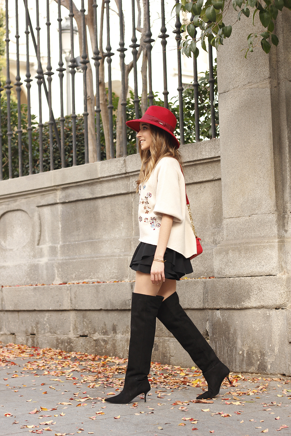 beige jersey with embroidered flowers over the knee black boots red hat street style fashion inspiration outfit03