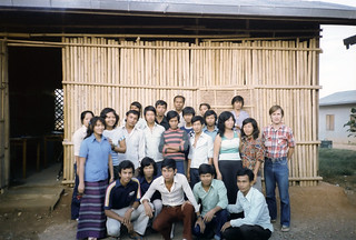 Tom Riddle with Cambodian refugee students in the Panat Nikhom Processing Center in 1983