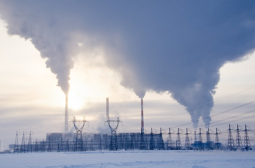 Gas power plant in cold winter landscape during sunset