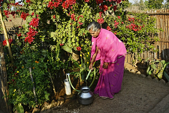 A woman fills water at her home at Makhala.