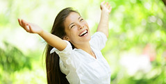 Carefree elated cheering woman in spring or summer