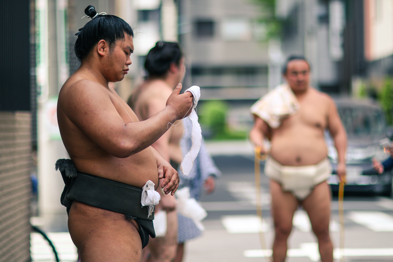Sumo fighters on the street