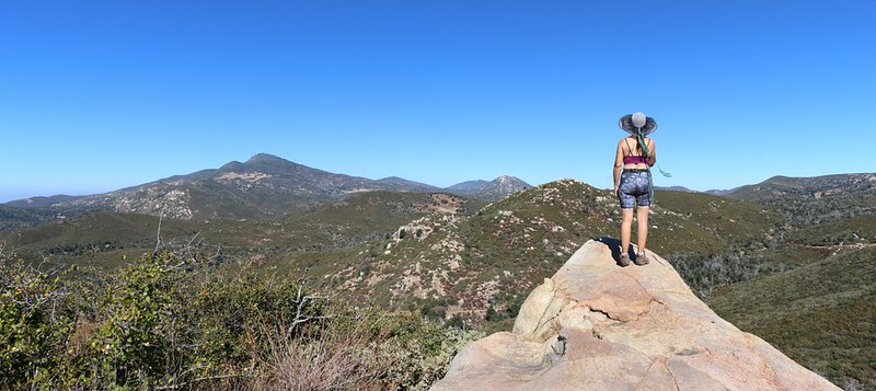 Vicki on a granite outcrop looking north from the Upper Descanso Creek Trail toward Cuyamaca Peak