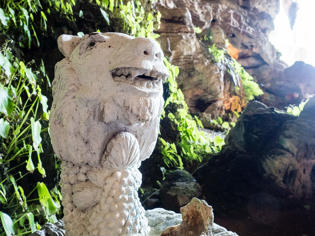 A white lion stone sculptures in the temple