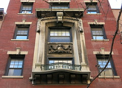 """A """"prominent"""" two-story window frame with balcony, 12 Fifth Avenue (1910), Greenwich Village, New York"""